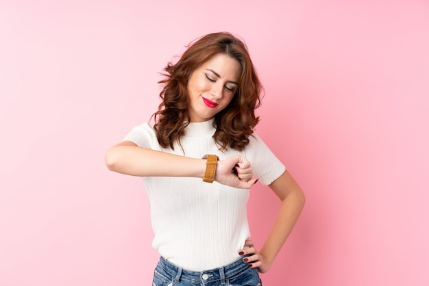 Young woman looking the wrist watch