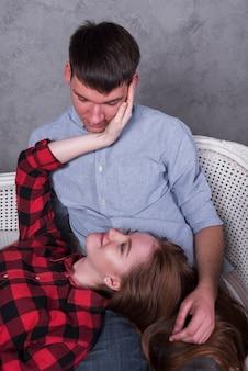 Young woman lying on man lap
