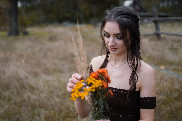 Young woman making a bouquet of wildflowers