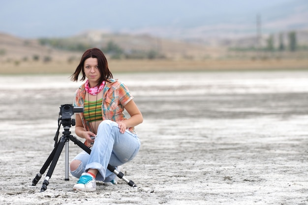 Young woman making film