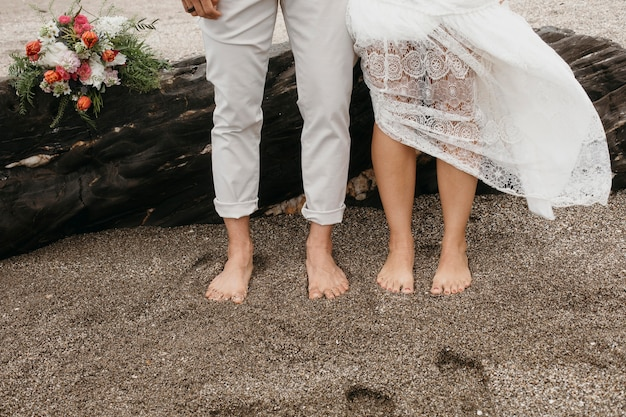 Young woman and man having a beach wedding