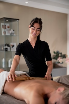 Young woman massaging her client in her salon Premium Photo