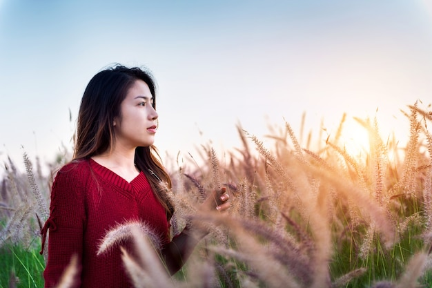 Young woman and meadow at sunset.