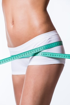 Young woman measuring perfect shape of beautiful thigh healthy lifestyles concept