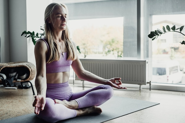 Young woman meditates while practicing yoga. freedom concept.
