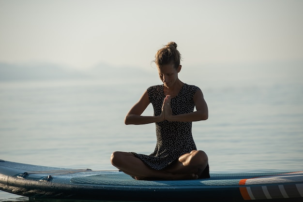 Young woman meditating in the morning