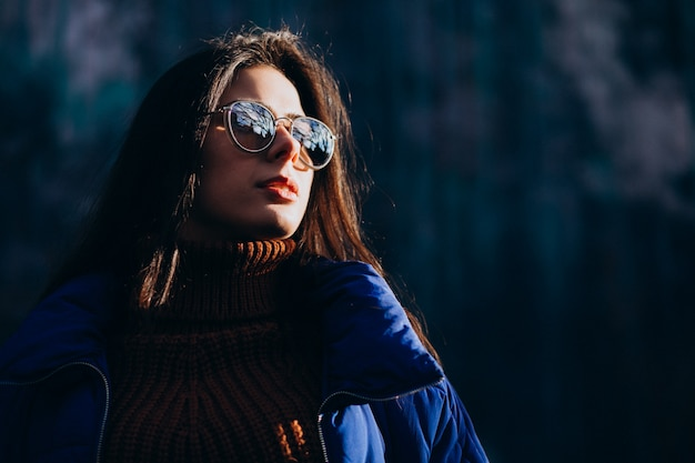 Young woman model in blue winter jacket
