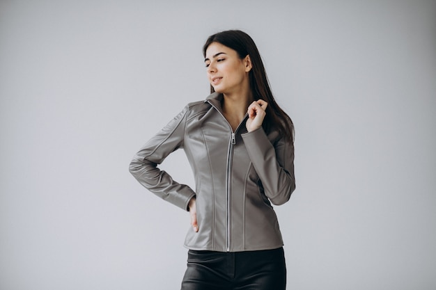 Young woman model wearing gray leather jacket