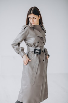 Young woman model wearing long gray coat