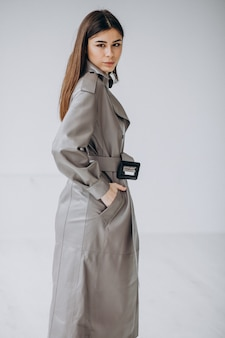 Young woman model wearing long grey coat