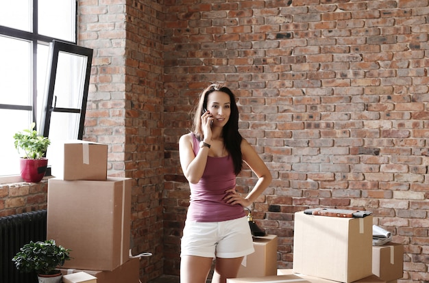 Young woman moving on her new apartment Free Photo
