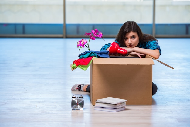 Young woman moving personal belongings