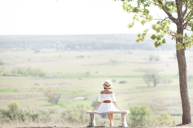 Young woman on nature  freedom. female free.  lady admires amazing natural view. woman admires a landscape.