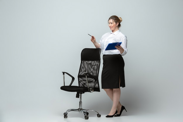 Young woman in office attire body positive female character feminism beauty concept