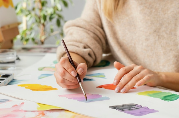 Young woman painting with watercolors