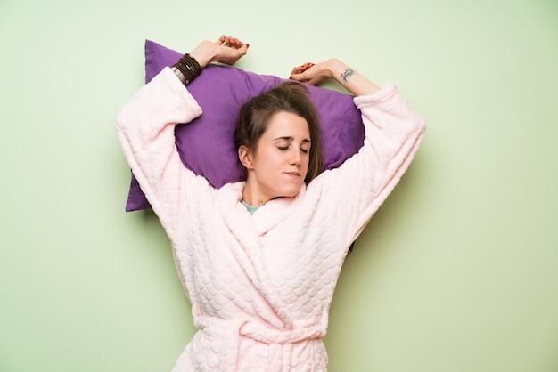 Young woman in pajama yawning