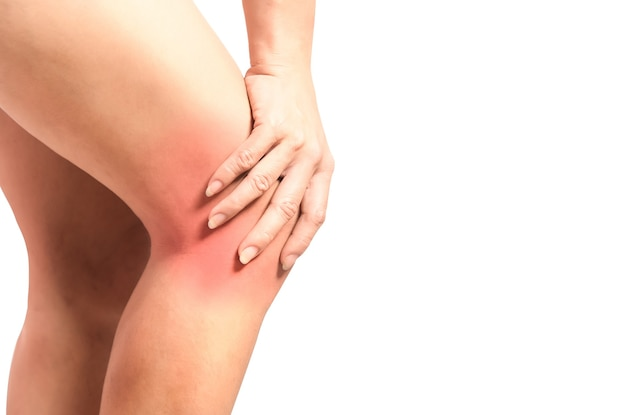 Young woman papation on knee joint with knee sprain or osteoarthritis knee joint