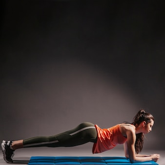 Young woman performing plank
