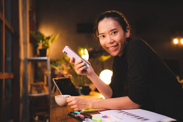 Young woman person using mobile phone to connecting with cyberspace communication, holding smartphone and texting message, female people happy with smart technology, girl lifestyle for business online