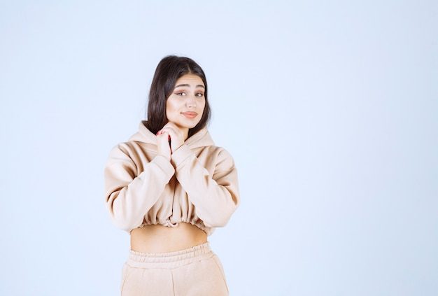 Young woman in a pink hoodie giving lovely and heartful poses