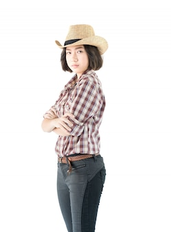 Young woman in a plaid shirt and arms crossed