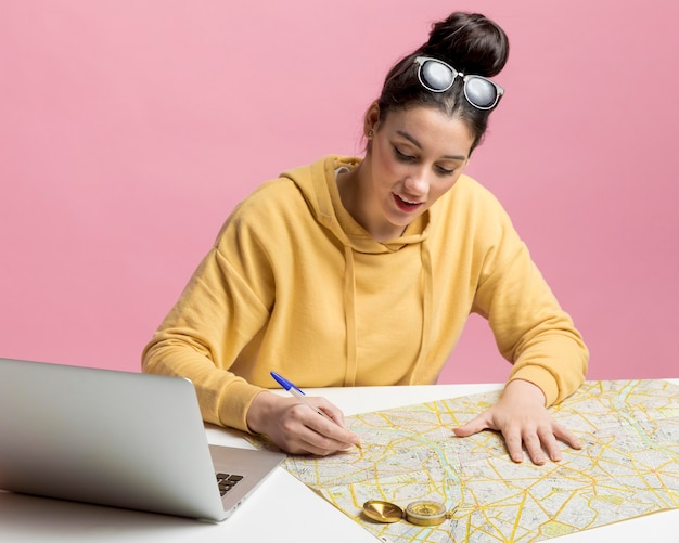 Young woman planning a new adventure