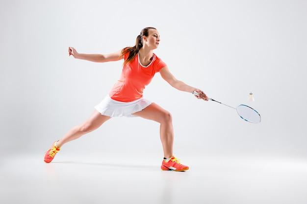 Young woman playing badminton