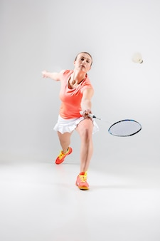 Young woman playing badminton