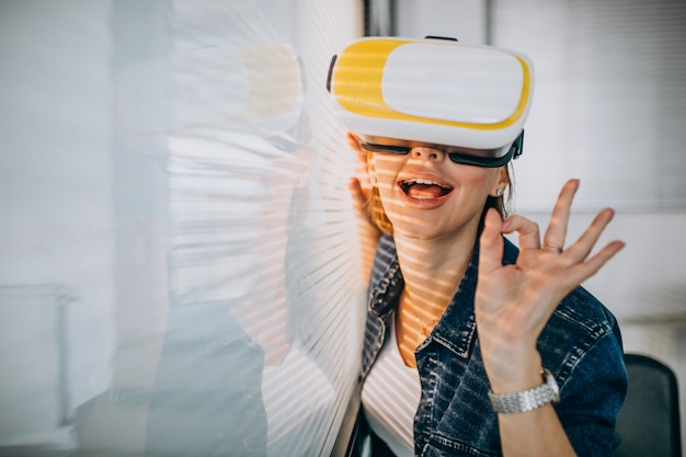 Young woman playing game through the vr glasses