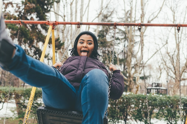 Young woman playing swing