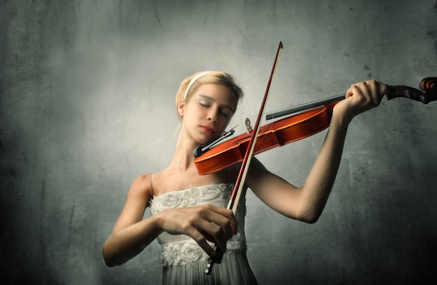 Young woman playing on a violin