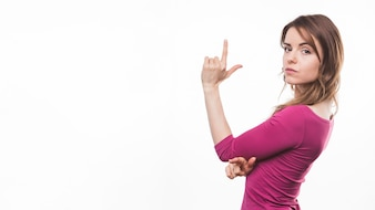 Young woman pointing her index finger upward against white background