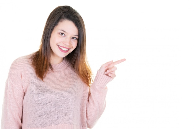 Young woman pointing side copyspace looks in camera
