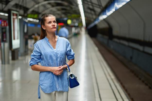 Young woman portrait inside metro subway.