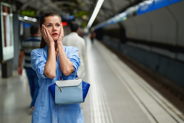 Young woman portrait inside metro subway