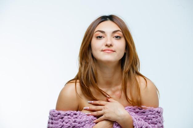 Young woman posing in knitwear