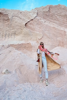 Young woman posing on a pink salt mountain