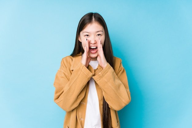 Young woman posing shouting excited to front