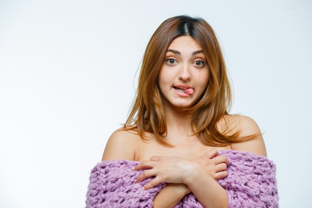Young woman posing silly in knitwear