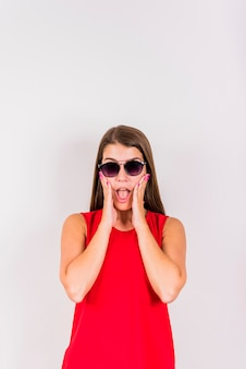 Young woman posing while surprising