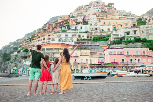 Young woman in positano village on the background