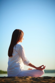 Young woman practicing meditation