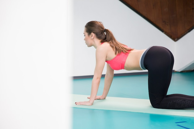 Young woman practicing pilates at the gym