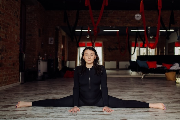 Young woman practicing yoga and fly yoga concept