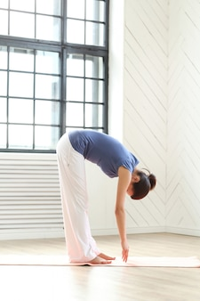 Young woman practicing yoga on a yoga mat