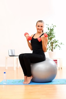 Young woman practising pilates