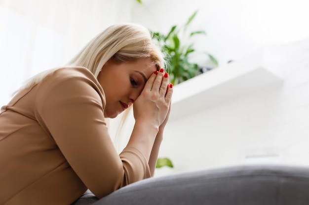 Young woman prays at home