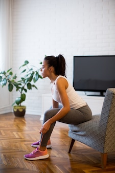 Young woman preparing for exercise at home