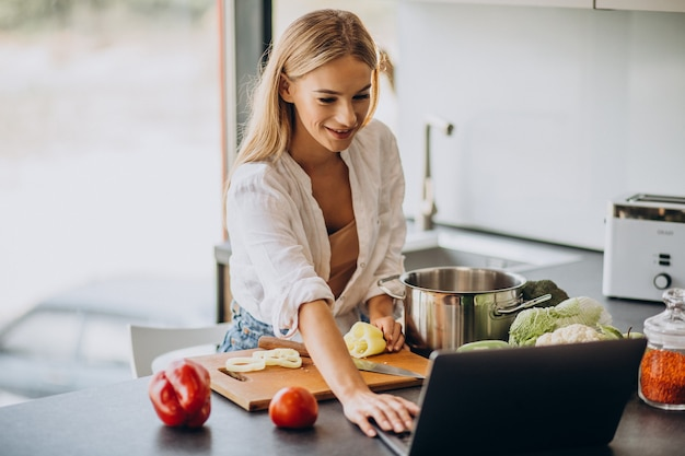 Young woman preparing food at the kitchen