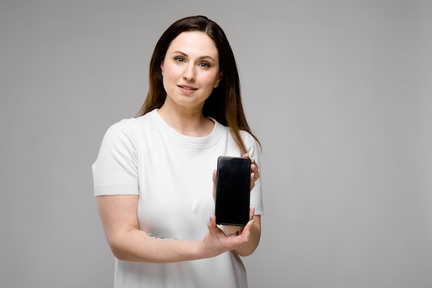 Young woman presenting telephone